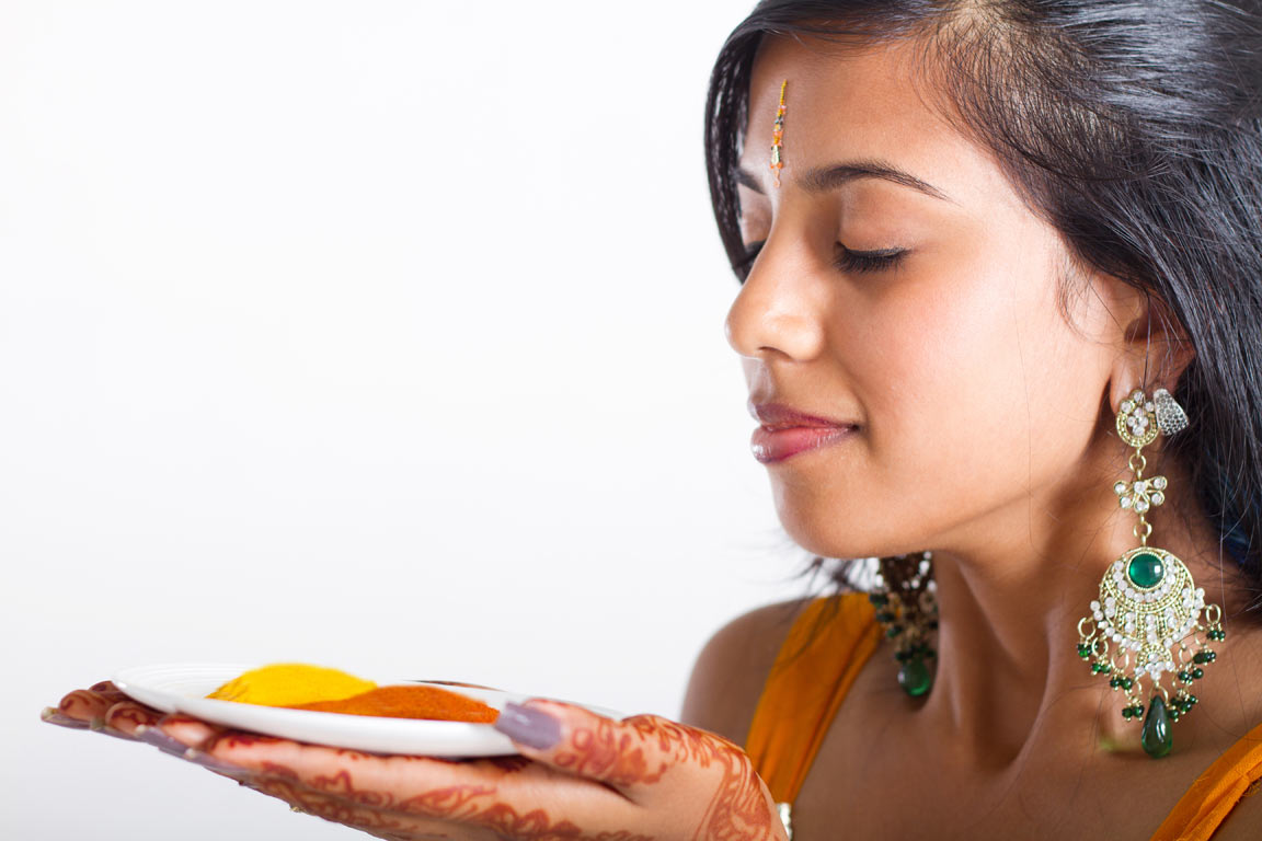Indian woman with turmeric